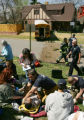 Paramedics and Fire personnel treat injured children on the front lawn of a home after a school...