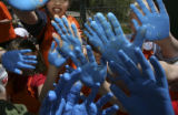 A sea of blue hands of kids after painting the wall with their prints. Kullerstrand Elementary...