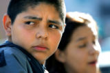 Hill Middle School 8th graders Martin Ramirez (cq, left), 14, glances away while talking about the...