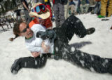David Eglsaer, cq, and Jessie Sipkovsky, cq, both of Beaver Creek, have a snow fight during a work...