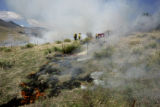 Firefighters work a prescription burn Wednesday, April 12,2006 at the Ken-Caryl Ranch open space,...