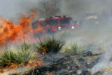 A West Metro brush truck provides a wet line during a prescription burn Wednesday, April 12,2006...