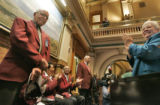 Standing for applause on the house floor are five of the original members of the Tuskegee Airmen....