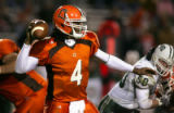 Bowling Green State University quarterback Omar Jacobs (#4) launches a pass for a TD the game...