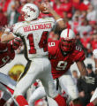 STATE14.SP.112605.EDH -- NC State's Mario Williams (9) and Manny Lawson kept the pressure on...