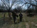 walking, photo by dentry for friday Brock Kastanek, left, carrying a camouflage blind, and Tom...