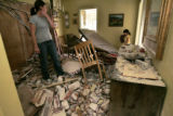 In Denver, Colo. 4/26/06 Tracey Lepine (cq) takes a look around the rubble in her home along with...