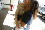 Virginia Rios, CQ, 17, hugs her friend Yesenia,CQ, 20, at her home Sunday April 2, 2006. Rios was...
