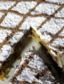 Bastilla, layers of chicken, eggs and crushed almonds encased in phyllo pastry, all topped with...