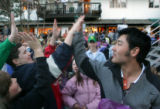 Toby Dawson (cq), high-fives a group of young fan s after he was honored by the city of Vail with...