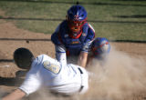 Cherry Creek catcher Garrett Duman tags out Mullan's  Brett Skene at home in the bottom of the 4th...