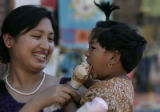 The Pearl Street Mall offers a lot of delights and Ruby Shrestha (cq) helps her daughter Sarina,...