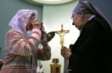 (cq) L-R Margaret Kalmanek (cq) drinks wine offered by Sister Winnifred (cq) during the...