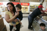 "Raquel Bolanos (cq) , 40, shops at the ""El Paisa"" bakery in Aurora on Wednesday April..."