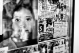 14 year-old  Erica Ruano (cq) stands by a protest poster in Colfax business front window in...