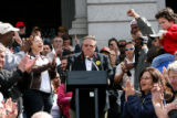 Paul Mendrick, cq, of the Colorado AFL-CIO receives applause at a union rally on the west steps of...
