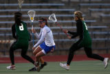 (l-r) Smoky Hill's Nicole Nguyen (#8, left) and Cortney Brooks (right) flank Cherry Creek's Lauren...