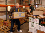 (DENVER Colo., January  28, 2005)  Ken Hendrick loads a pallet of food for the University Church...