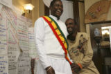 Adrian Mangituka, left from the Congo, was master of ceremonies, white outfit with sash gets a...