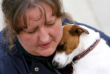 Dakota Wilhelm, cq, of The Barking Lot in Arvada hugs a clients jack russell terrier. The Barking...