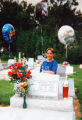 Jonathan Swain, at the age of 13, visits the gravesite of his friend, Ryan Chedester, in...