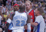 Los Angeles Clippers center Chris Kaman, right, gets seperated from Denver Nuggets forward Ruben...
