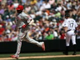 Phillis Ryan Howard rounds the bases after hitting a home-run at Coors Field Sunday afternoon...