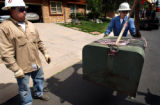 (LITTLETON, Colo., June 8, 2004)    Excel Energy utility worker Mathew Abeyta (left) and...
