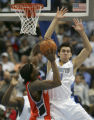 (DENVER, Colo., March 16, 2005)  Eduardo Najera defends against the shot by Melvin Ely in the...