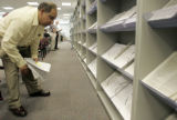 Kanyon Inayat (cq) searches for tax forms at the IRS office at 600 17th St. in  Denver, Monday...
