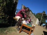 (NYT72) MBARE, Zimbabwe -- May 1, 2006 -- ZIMBABWE-INFLATION-3  -- An unlicensed vendor sells...