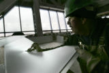 {Denver, Colorado.  March 23, 2005}.    Sheet metal journeyman Jim Bendt (cq Jim Bendt) uses tin...