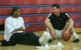 Denver Nuggets forward Carmelo Anthony, left, and Nugget's General Manager Kiki Vandeweghe discuss...