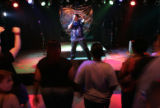 "Corey White (cq), 27, preform karaoke to ""Bodies"" by Drowning Pool at the Iliff Park..."