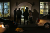 Investigating a shooting Denver police officers question witnesses outside the Grupo Esperanza y...