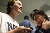 Bambi Brittain (cq), left, and Alia McCut (cq) listen to a Mariah Carey song on Brittain's phone...
