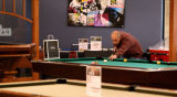 Joe Buseman, cq, who recently purchased a billiards table, stops by  the Brunswick  Home &...