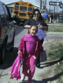 (FOREGROUND TO Background) Melyssa Vargas (CQ), 6, of Commerce City is picked up from 3C Daycare...