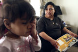 (BACKGROUND TO FOREGROUND) Joann Vargas (CQ), 37, of Commerce City questions her 4-year-old...