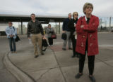 At RTD Park and Ride at I-25 and Broadway, light rail riders like Susan Wilson (cq) (front) wait...