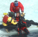 Nate Giles (cq) a diver with the Summit County Rescue Group gets onto  the three foot thick  ice...