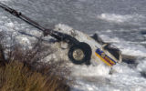 The missing truck is pulled from under  three foot thick  ice at Dillon Reservoir on Friday April...