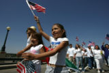 Samuel Trujillo walks with his daughters Myah Trujillo, 8, (second from left) and Angel Trujillo,...