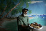 FOR WORLD PLATE:  Lance Huggins (cq) the owner of the Caribbean Bakery, shows off some of his...
