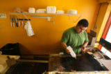 Mexican native Marcos Vargas (CQ), 22, of Denver works in his family's restaurant Tacotlan on...