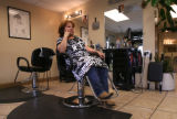 Mexican Native Gloria Fierro (CQ), 50, of Denver, takes a break in her sisters beauty shop Maria's...