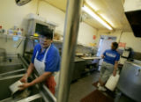 Maria Robledo (cq), left, washes dishes during a slow period at Chubby's located at 160 N Federal...