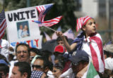 Olga Fuss (cq), waves a U.S. flag as over 75,000 rallied for immigrant's rights at the State...