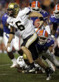 Vanderbilt Quarterback jay Cutler (6) escapes the rush of Florida's Todd McCullough (47) and other...