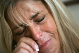 Carol Vizzi, CQ, 52, is assaulted by emotions while remembering her son Justin Goodman during an...